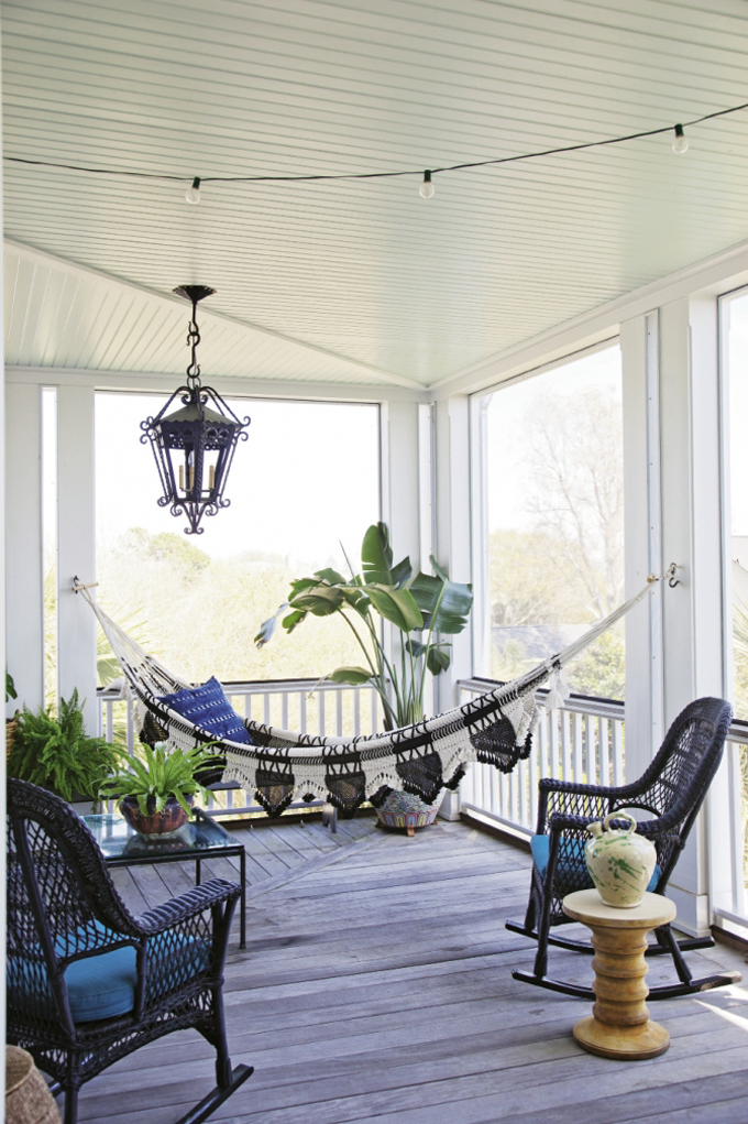 Porch with bistro lights and a hammock